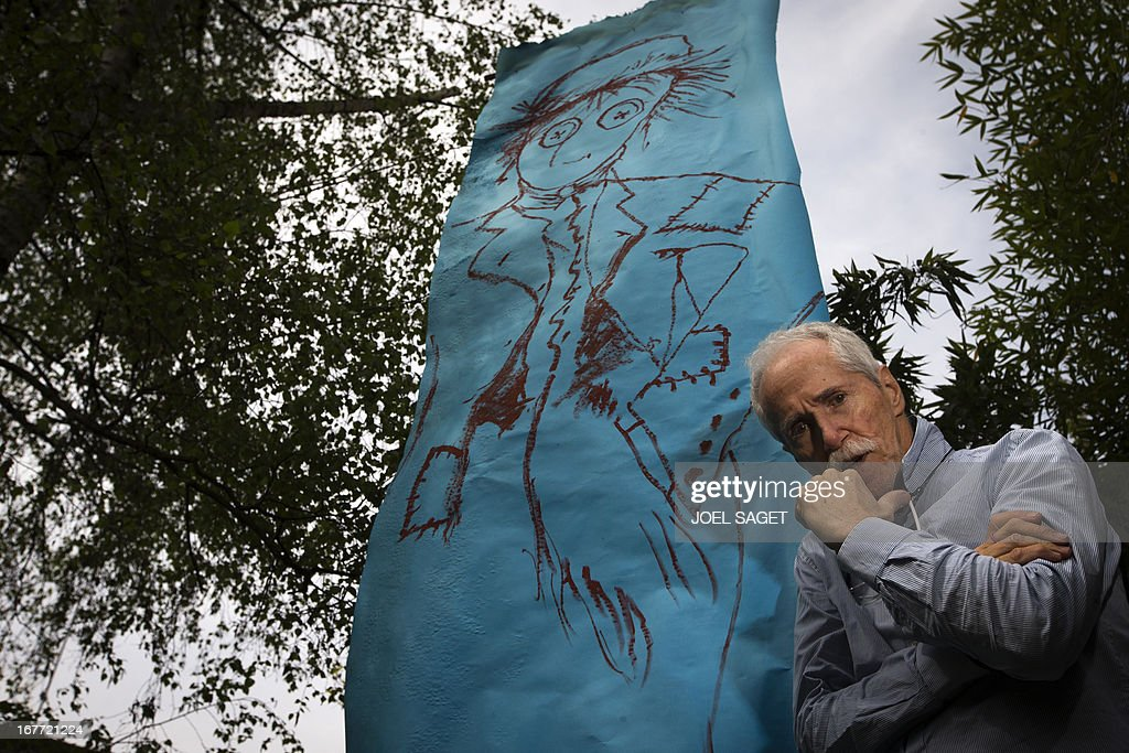 US designer and artist Joseph Hilton McConnico poses in the garden of his workshop in the Bagnolet suburb of Paris on April 26, 2013 before an upcoming exhibition. It may be because in the city 'shadows are sharper than in the countryside' that Hilton McConnico, 69, chose to install a field of flax 1,000 m2 near the Louvre Museum in Paris for the open air exhibition 'L'incroyable récolte' ('The incredible harvest') to be held from June 3 to 9. AFP PHOTO / JOEL SAGET