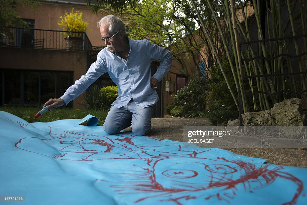 US designer and artist Joseph Hilton McConnico works in the garden of his workshop in the Bagnolet suburb of Paris on April 26, 2013 before an upcoming exhibition. It may be because in the city 'shadows are sharper than in the countryside' that Hilton McConnico, 69, chose to install a field of flax 1,000 m2 near the Louvre Museum in Paris for the open air exhibition 'L'incroyable récolte' ('The incredible harvest') to be held from June 3 to 9.