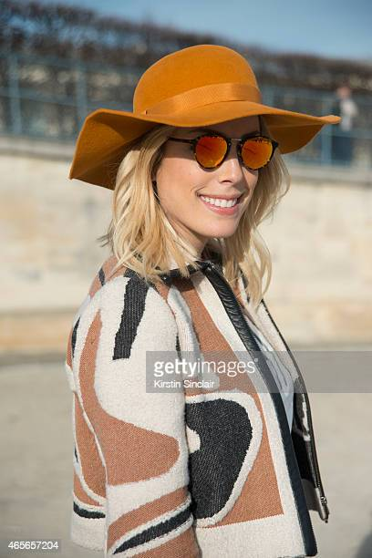 Designer and blogger Fabiana Justus wears a Graciella Starling hat Phillip Lim bag Zara shoes Coven jacket Pop Up Store top and Spectre sunglasses on...