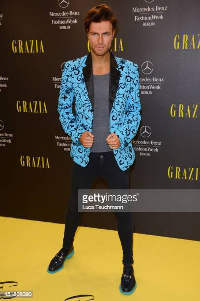 Designer Andre Borchers arrives for the Opening Night by Grazia fashion show during the MercedesBenz Fashion Week Spring/Summer 2015 at Erika Hess...