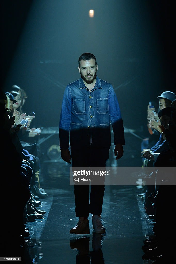 Designer <a gi-track='captionPersonalityLinkClicked' href=/galleries/search?phrase=Andrea+Pompilio+-+Fashion+Designer&family=editorial&specificpeople=12906460 ng-click='$event.stopPropagation()'>Andrea Pompilio</a> appears on the runway during the Onitsuka Tiger x ANDREA POMPILIO show as part of Mercedes Benz Fashion Week TOKYO 2014 A/W at the bellesalle SHIBUYA GARDEN on March 20, 2014 in Tokyo, Japan.