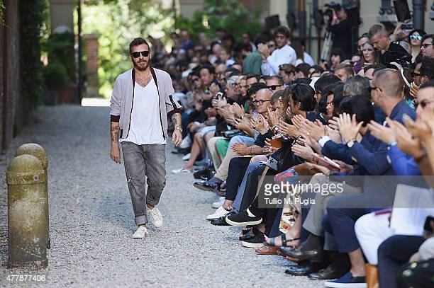 Designer Andrea Pompilio walks the runway after his fashion show as part of Milan Men's Fashion Week Spring/Summer 2016 on June 20 2015 in Milan Italy