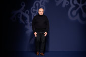 Designer Andrew Gn salutes the public after his show as part of the Paris Fashion Week Womenswear Fall/Winter 2016/2017 on March 4 2016 in Paris...