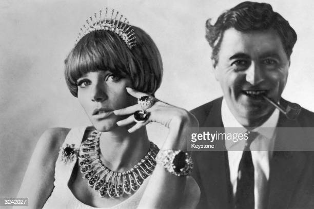 Designer Andrew Grima with a model wearing a selection of his modern jewellery