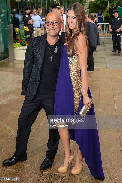 Designer Angel Sanchez and TV personality Dayana Mendoza enter the 2013 CFDA Fashion Awards on June 3 2013 in New York United States