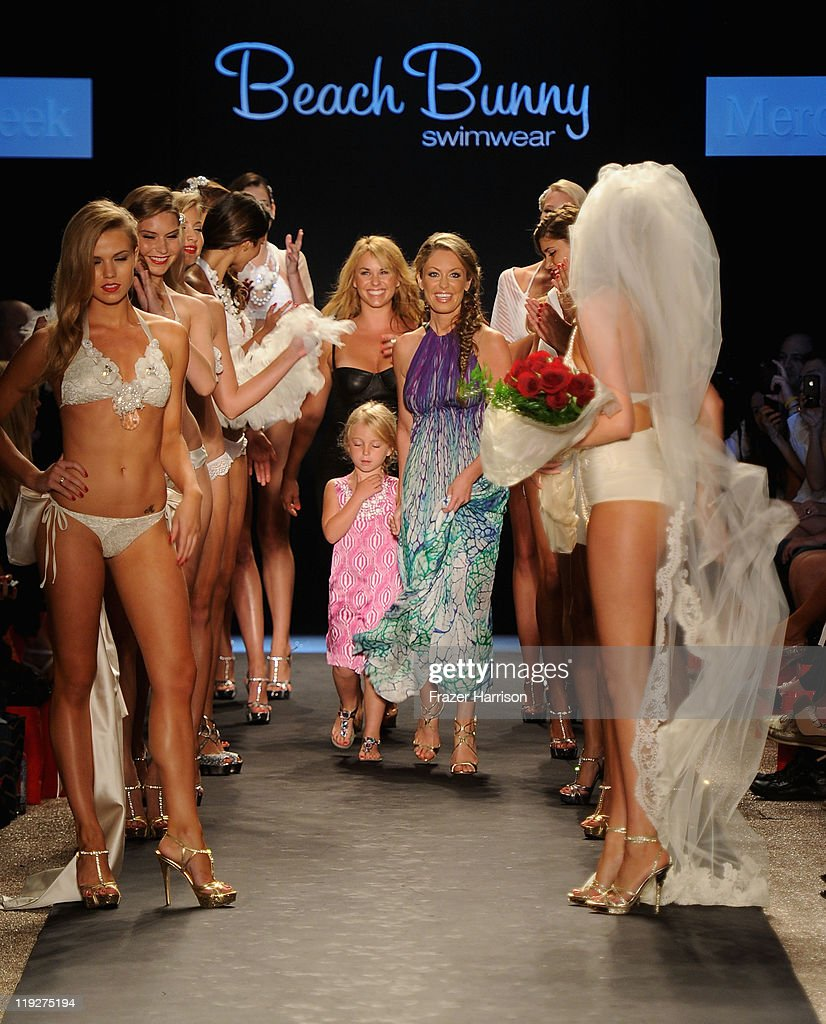 Designer Angela Chittenden, daughter Presley and model <a gi-track='captionPersonalityLinkClicked' href=/galleries/search?phrase=Kate+Upton&family=editorial&specificpeople=7488546 ng-click='$event.stopPropagation()'>Kate Upton</a> walk the runway at the Beach Bunny Swimwear show during Merecdes-Benz Fashion Week Swim 2012 at The Raleigh on July 15, 2011 in Miami Beach, Florida.