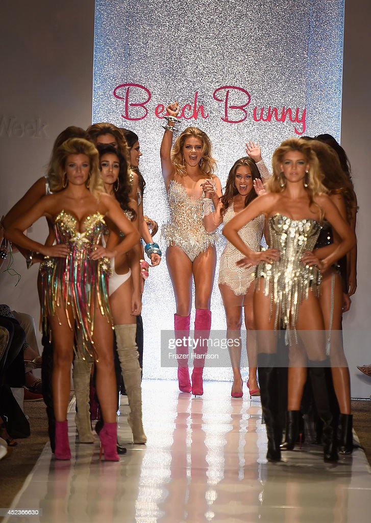 Designer Angela Chittenden walks the runway with models at the Beach Bunny Featuring The Blonds show during MercedesBenz Fashion Week Swim 2015 at...