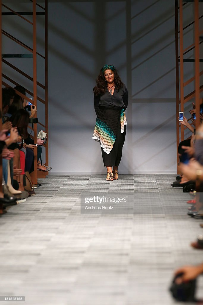 Designer <a gi-track='captionPersonalityLinkClicked' href=/galleries/search?phrase=Angela+Missoni&family=editorial&specificpeople=2081418 ng-click='$event.stopPropagation()'>Angela Missoni</a> acknowledges the applause of the audience after the Missoni show as part of Milan Fashion Week Womenswear Spring/Summer 2014 at on September 22, 2013 in Milan, Italy.