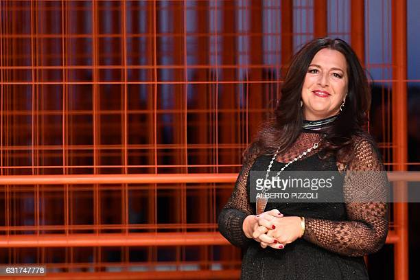 Designer Angela Missoni greets the audience at the end of the show for fashion house Missoni during the Men's FallWinter 20172018 fashion week on...
