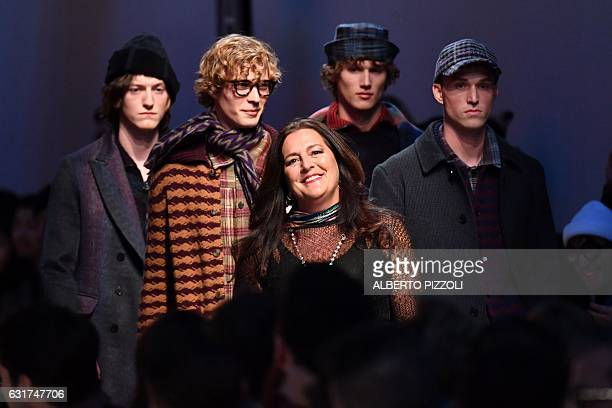 Designer Angela Missoni stands with models at the end of the show for fashion house Missoni during the Men's FallWinter 20172018 fashion week on...