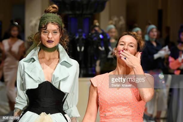 Designer Anja Gockel acknowledges the applause of the audience at the Anja Gockel show during the MercedesBenz Fashion Week Berlin Spring/Summer 2018...