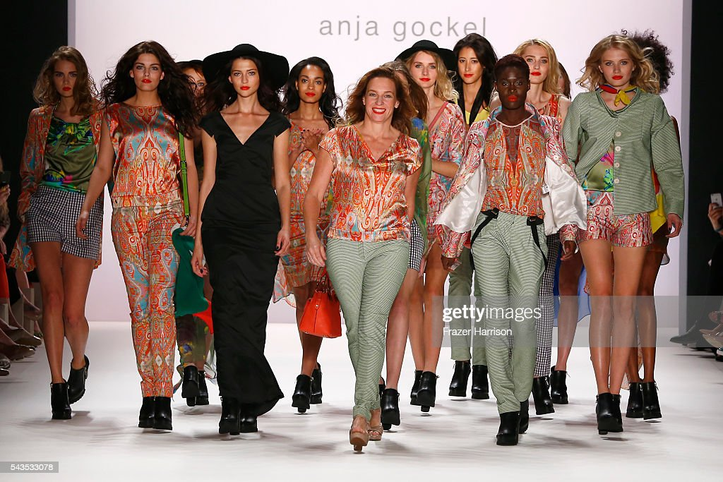 Designer Anja Gockel with a group of models walk the runway after her show during the Mercedes-Benz Fashion Week Berlin Spring/Summer 2017 at Erika Hess Eisstadion on June 29, 2016 in Berlin, Germany.