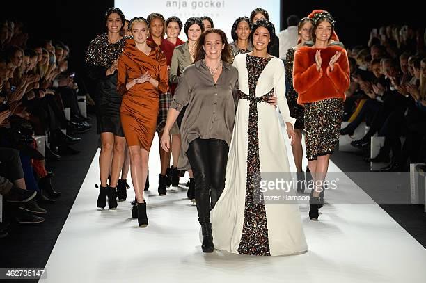 Designer Anja Gockel and model Rebecca Mir walk the runway at the Anja Gockel show during MercedesBenz Fashion Week Autumn/Winter 2014/15 at...