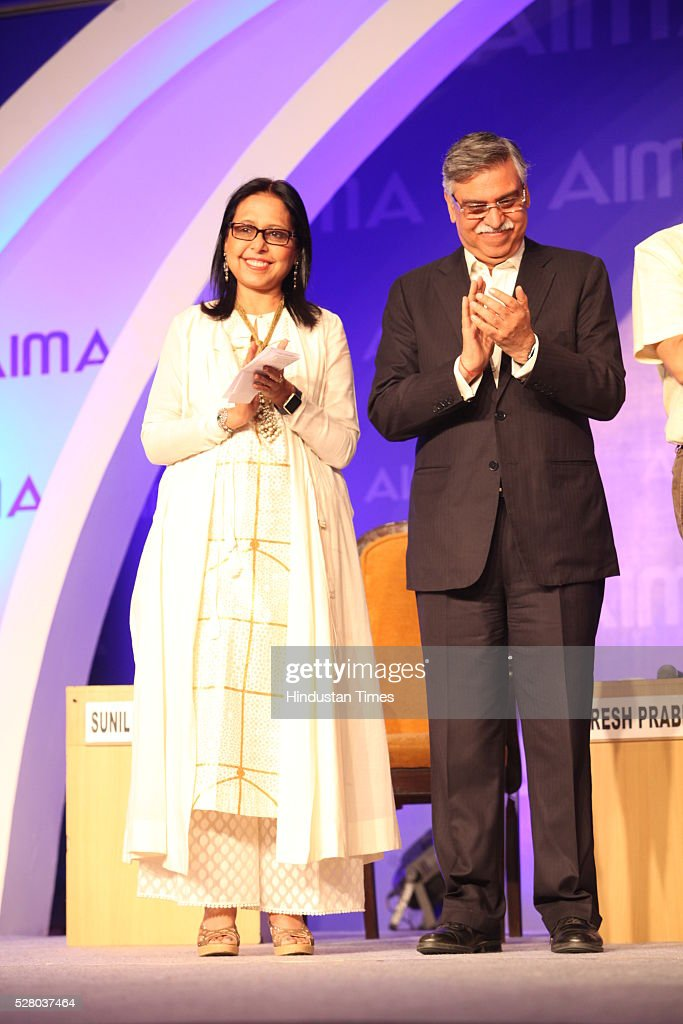 Designer Anju Modi with Industrialist Sunil Kant Munjal during the All India Management Association (AIMA)s Managing India Awards 2016 at Hotel Taj Palace in New Delhi, India.