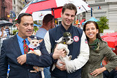 Designer Anthony Rubio United States Olympian Tim Morehouse and Animal Fair founder Wendy Diamond attend Doggupy 2012 in Union Square on October 2...
