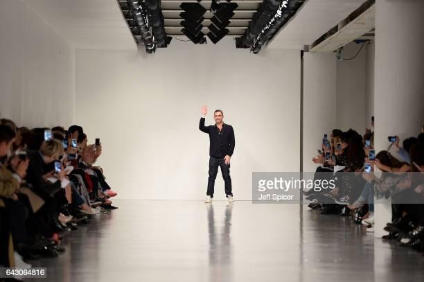 Designer Antonio Berardi salutes the crows following the runway at the Antonio Berardi show during the London Fashion Week February 2017 collections...