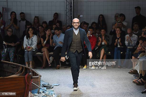 Designer Antonio Marras acknowledges the applause of the public after the Antonio Marras fashion show as part of Milan Men's Fashion Week...