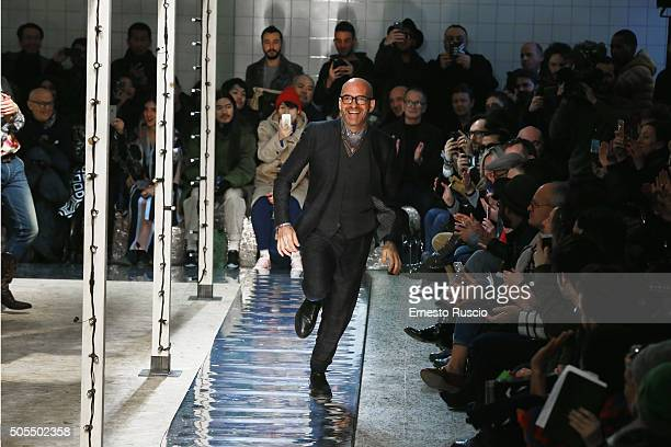 Designer Antonio Marras acknowledges the applause of the public after the Antonio Marras show during Milan Men's Fashion Week Fall/Winter 2016/17 on...
