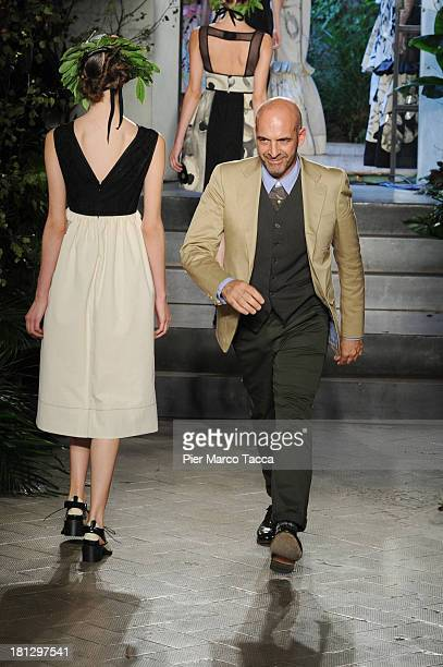 Designer Antonio Marras acknowledges the audience at the end the Antonio Marras show as a part of Milan Fashion Week Womenswear Spring/Summer 2014 on...