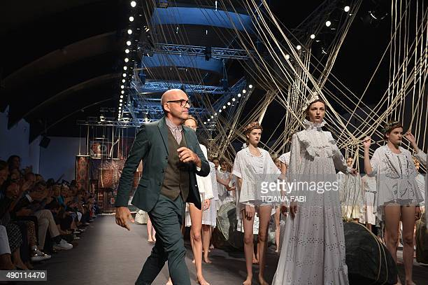 Designer Antonio Marras greets the audience at the end of his show during the women Spring / Summer 2016 Milan's Fashion Week on September 26 2015 in...