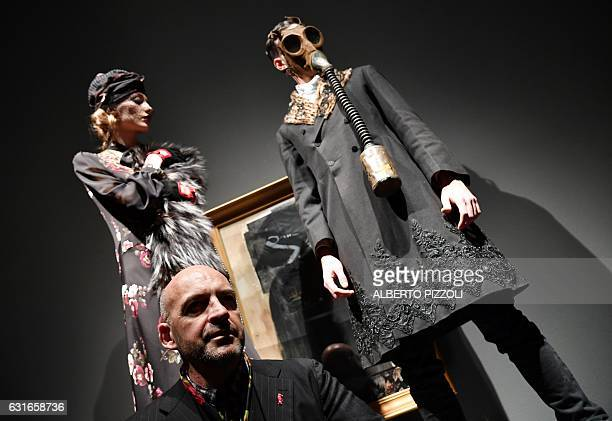 Designer Antonio Marras poses with models during the Men's FallWinter 20172018 fashion week on January 14 2017 in Milan / AFP / Alberto PIZZOLI