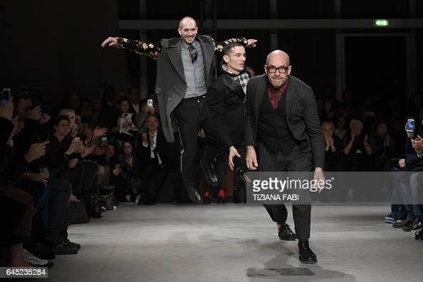 TOPSHOT Designer Antonio Marras runs to greet the audience at the end of his show during the Women's Fall/Winter 2017/2018 fashion week in Milan on...