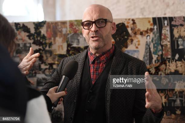 Designer Antonio Marras speaks to journalists backstage before the show for fashion house Antonio Marras during the Women's Fall/Winter 2017/2018...