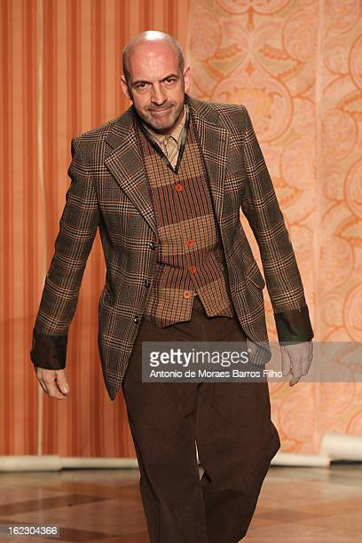 Designer Antonio Marras walks the runway at the Antonio Marras fashion show during Milan Fashion Week Womenswear Fall/Winter 2013/14 on February 21...