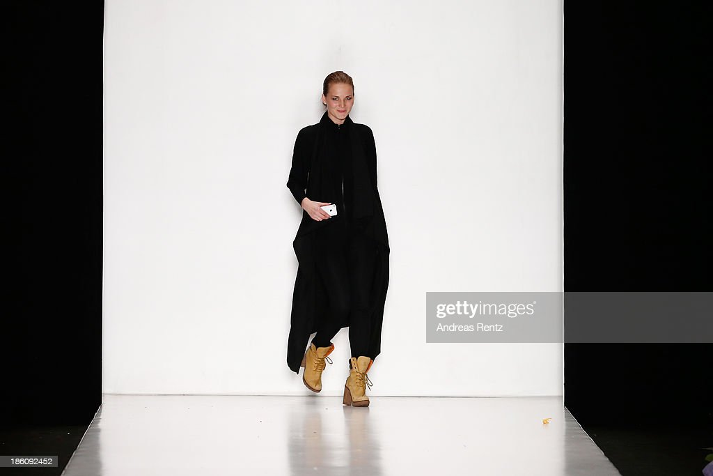 A designer appears on the runway for the finale of the Contrfashion show during Mercedes-Benz Fashion Week Russia S/S 2014 on October 28, 2013 in Moscow, Russia.