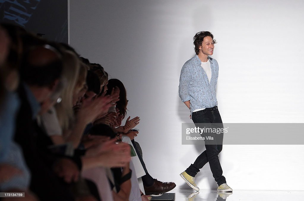 Designer Arthur Arbesser acknowledges the pubblic during 'Who Is On Next?' Altaroma Vogue Italia fashion show as part of AltaRoma AltaModa Fashion Week at Santo Spirito In Sassia on July 8, 2013 in Rome, Italy.