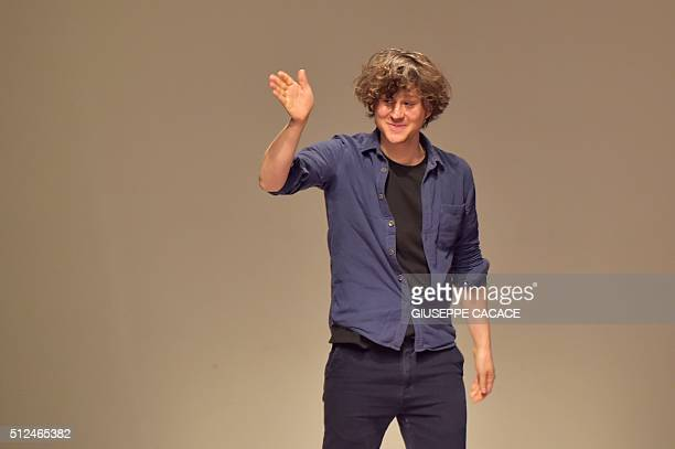 Designer Arthur Arbesser greets the audience at the end of the show for fashion house Iceberg during the Women Autumn / Winter 2016 Milan Fashion...