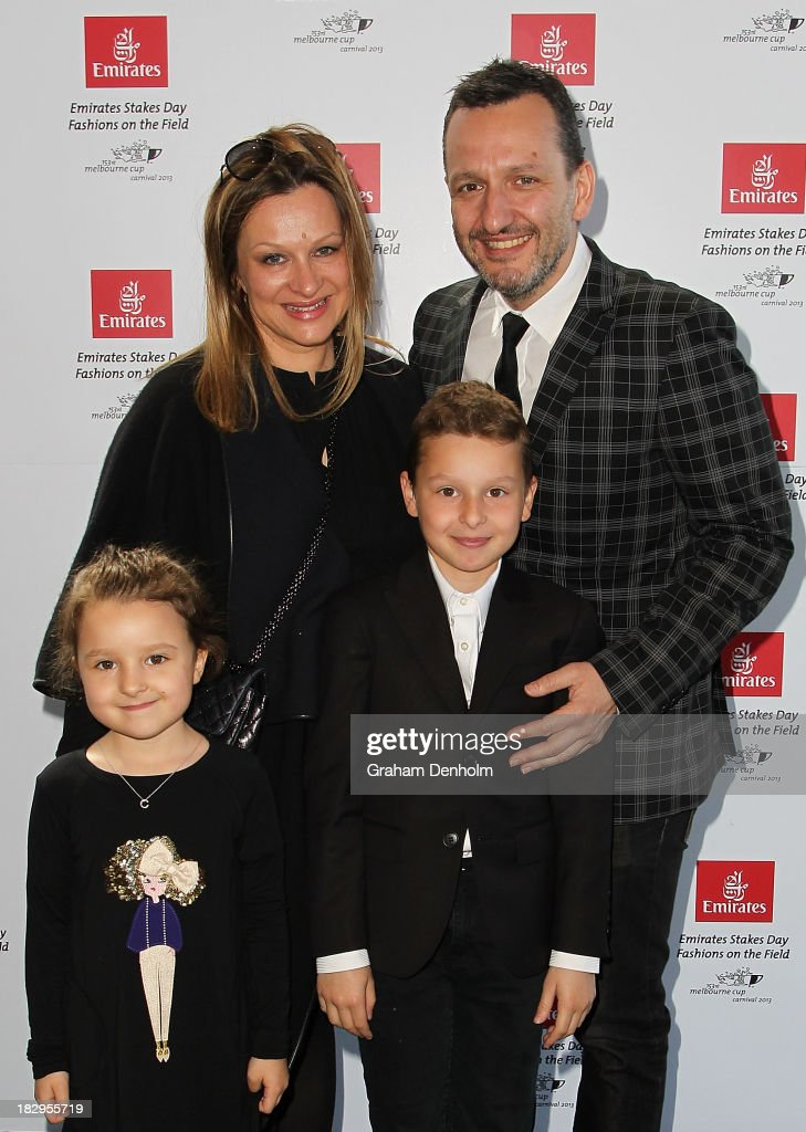 Designer <a gi-track='captionPersonalityLinkClicked' href=/galleries/search?phrase=Arthur+Galan&family=editorial&specificpeople=2237960 ng-click='$event.stopPropagation()'>Arthur Galan</a> and his wife Mimi Galan pose with their children at the Emirates Stakes Day Fashion on the Field Launch at Flemington Racecourse on October 3, 2013 in Melbourne, Australia.