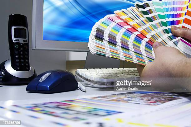 Designer Artist. Graphic designer selects colors to project.