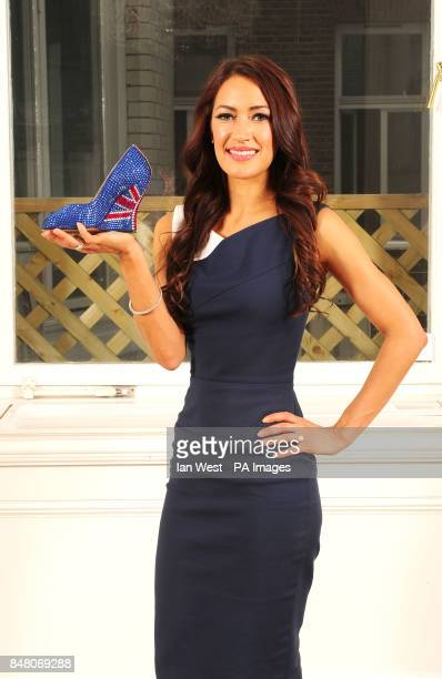 Designer Aruna Seth holding one half of her limited edition 'British shoes' to celebrate the Queen's Diamond Jubilee with a price tag of 3000 at...