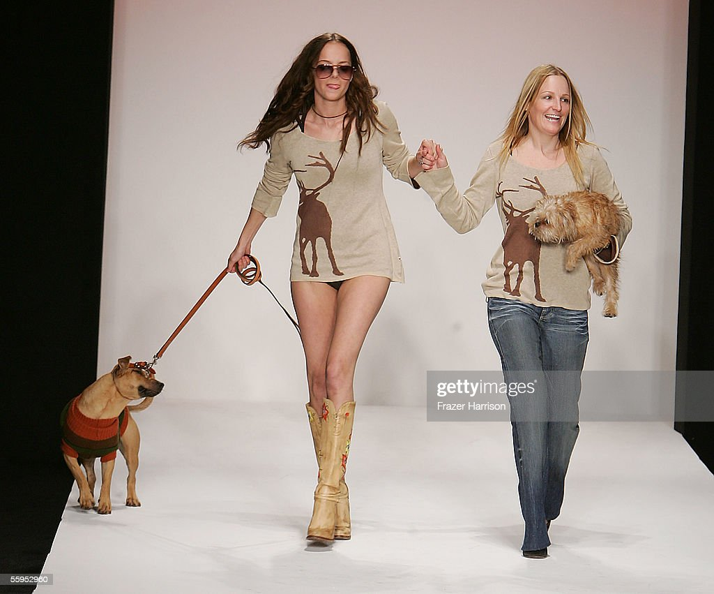 Designer ashley paige r and a model walk the runway at the ashley paige