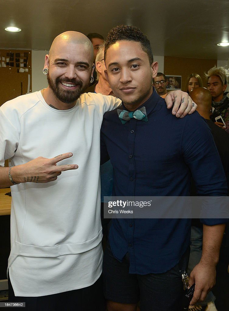 Designer Ashton Michael and <a gi-track='captionPersonalityLinkClicked' href=/galleries/search?phrase=Tahj+Mowry&family=editorial&specificpeople=2969025 ng-click='$event.stopPropagation()'>Tahj Mowry</a> attend at the Ashton Michael Spring 2014 Collection show on October 15, 2013 in Hollywood, California.