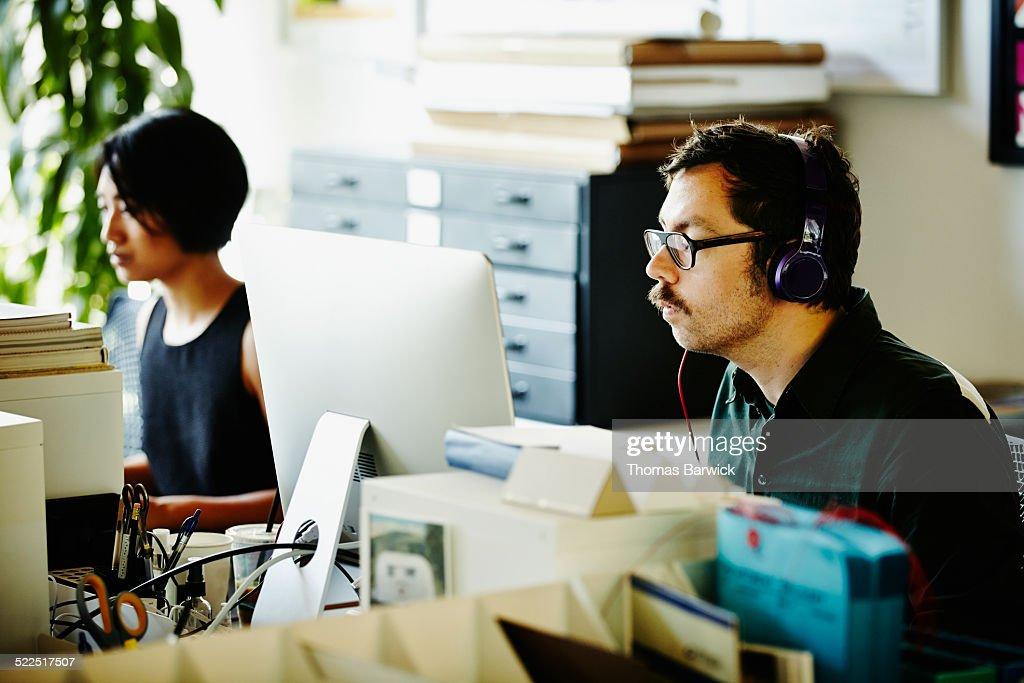 Designer at desk working on computer
