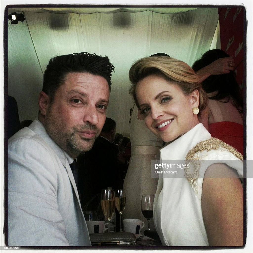Designer Aurelio Castarello and actor <a gi-track='captionPersonalityLinkClicked' href=/galleries/search?phrase=Mena+Suvari&family=editorial&specificpeople=156413 ng-click='$event.stopPropagation()'>Mena Suvari</a> pose in the Birdcage at Flemington Racecourse on November 8, 2012 in Melbourne, Australia.