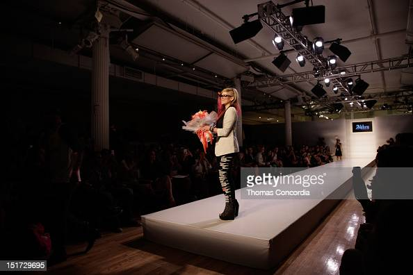 Designer Avril Lavigne acknowledges the crowd after the Abbey Dawn by Avril Lavigne Fashion Show presented by Inglot Cosmetics at STYLE360 on...