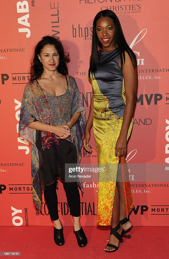 Designer Azin Valy of Cityzen by Azin and her muse arrive at Mr. C Beverly Hills on October 23, 2013 in Beverly Hills, California.