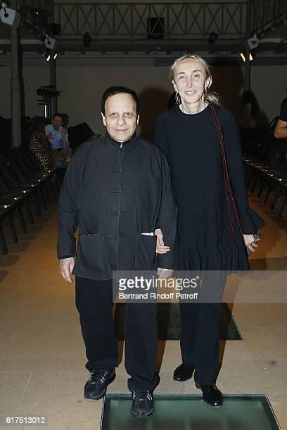 Designer Azzedine Alaia and Carla Sozzani attend the Azzedine Alaia Fashion Show at Azzedine Alaia Gallery on October 23 2016 in Paris France