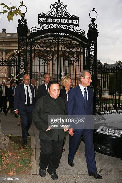 Designer Azzedine Alaia and Mayor of Paris Bertrand Delanoe arrive at the 'Azzedine Alaia exhibition' at Palais Galliera on September 25 2013 in...