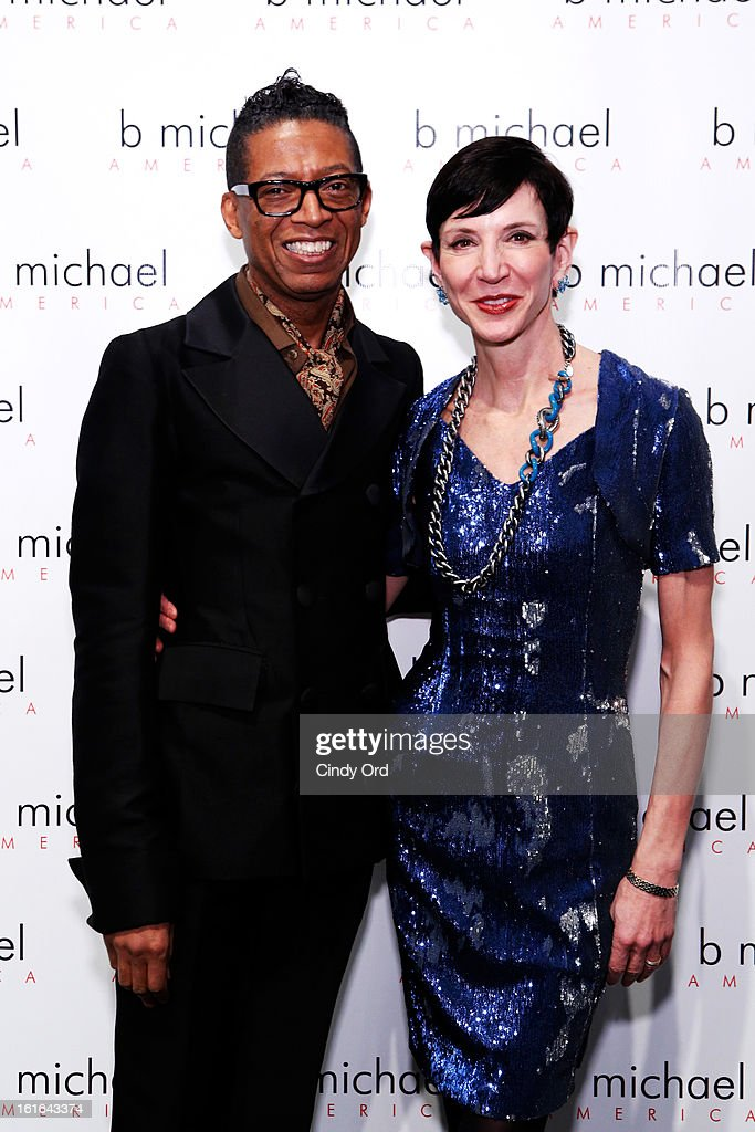 Designer B Michael and <a gi-track='captionPersonalityLinkClicked' href=/galleries/search?phrase=Amy+Fine+Collins&family=editorial&specificpeople=241319 ng-click='$event.stopPropagation()'>Amy Fine Collins</a> backstage at the B Michael America Fall 2013 fashion show during Mercedes-Benz Fashion Week at The Studio at Lincoln Center on February 13, 2013 in New York City.