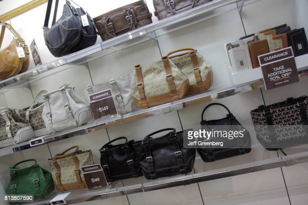 Designer bags for sale in a store at Miromar Outlets