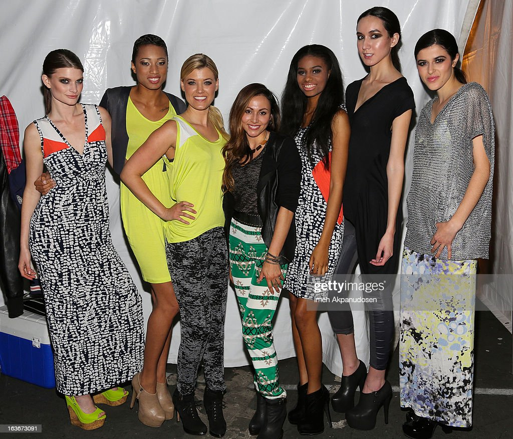 Designer Beatrice Guapo (C) of GG Collective poses backstage with models at the Sassi By Nancy E & GG Spring 2013 Swimsuit Collection fashion show as part of Los Angeles Fashion Week at Stage 22 on March 13, 2013 in Los Angeles, California.