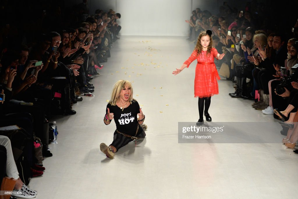 Designer <a gi-track='captionPersonalityLinkClicked' href=/galleries/search?phrase=Betsey+Johnson+-+Fashion+Designer&family=editorial&specificpeople=4205426 ng-click='$event.stopPropagation()'>Betsey Johnson</a> and her granddaughter walk the runway at the <a gi-track='captionPersonalityLinkClicked' href=/galleries/search?phrase=Betsey+Johnson+-+Fashion+Designer&family=editorial&specificpeople=4205426 ng-click='$event.stopPropagation()'>Betsey Johnson</a> fashion show during Mercedes-Benz Fashion Week Fall 2014 at The Salon at Lincoln Center on February 12, 2014 in New York City.