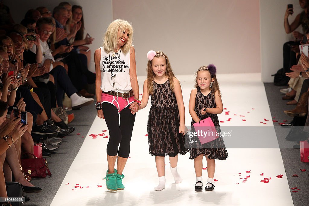 Designer Betsey Johnson and two girls walk the runway at the end of her show during the Mercedes-Benz Fashion Week Spring 2014 collection on September 11, 2013 in New York.