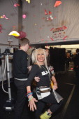 Designer Betsey Johnson poses for a photo backstage at the Betsey Johnson Fall 2013 fashion show during MercedesBenz Fashion Week at The Studio at...