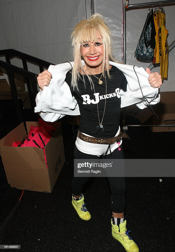 Designer Betsey Johnson poses for a picture backstage at the Betsey Johnson during Fall 2013 Mercedes-Benz Fashion Week at The Studio at Lincoln Center on February 11, 2013 in New York City.