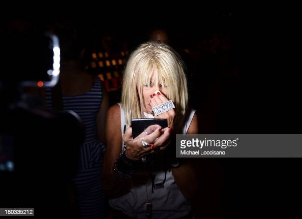 Designer Betsey Johnson prepares backstage at the Betsey Johnson fashion show during MercedesBenz Fashion Week Spring 2014 at The Studio at Lincoln...